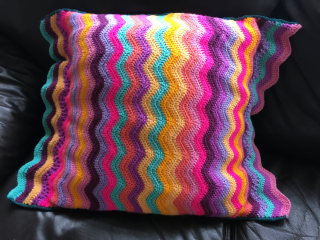 Striped crochet cushion